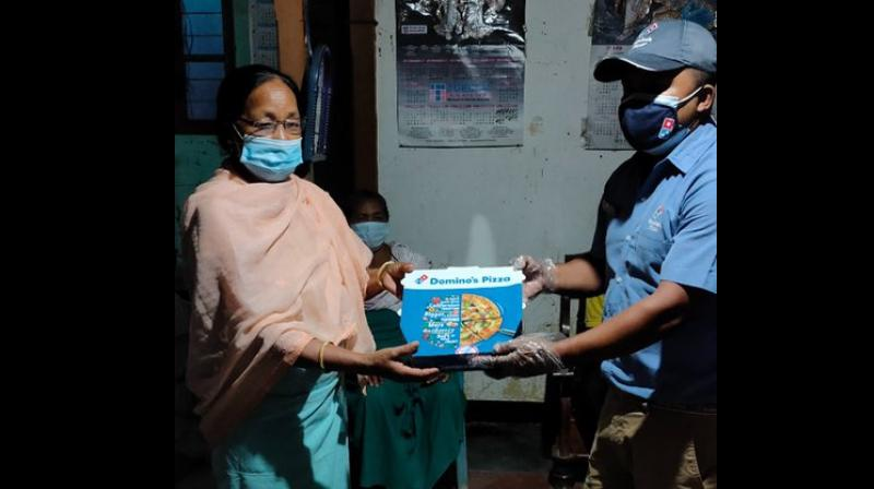 Free pizza being given to the family members of weightlifter Mirabai Chanu. (Photo: Twitter/@dominos_india)