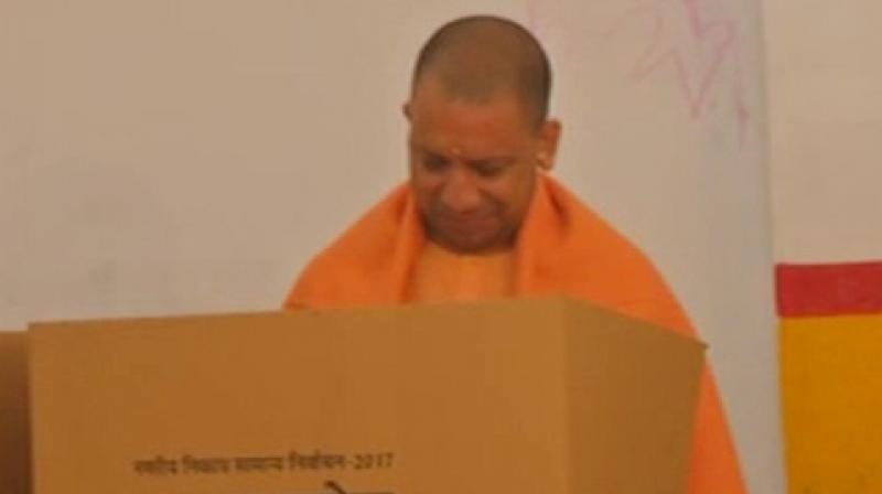 Uttar Pradesh Chief Minister Yogi Adityanath also reached a polling station in Gorakhpur and cast his vote. (Photo: ANI   Twitter)