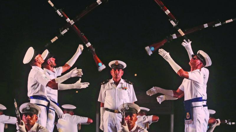 Indian Navy personnel display their skills during a rehearsal for Navy Day celebrations in Mumbai.