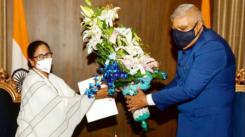 Trinamool Congress (TMC) supremo Mamata Banerjee (L) meets West Bengal governor Jagdeep Dhankhar at Raj Bhavan, in Kolkata, Monday, May 3, 2021. (PTI)
