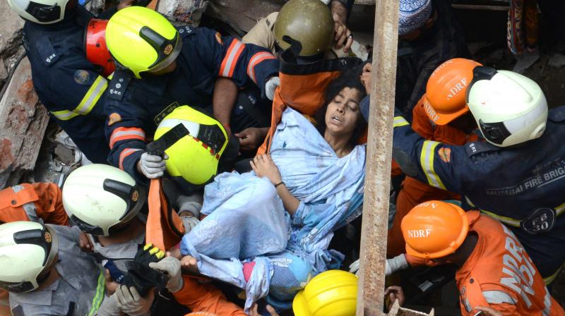 A lady being rescued out of the four-storey building which collapsed in Mumbai's Dongri area on Tuesday. (Photo: Rajesh Jadhav/ File).