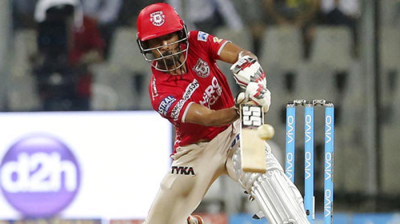 Kings XI Punjab player Wriddhiman Saha bats during their Indian Premier League (IPL) cricket match against Mumbai Indians in Mumbai. (Photo: AP)