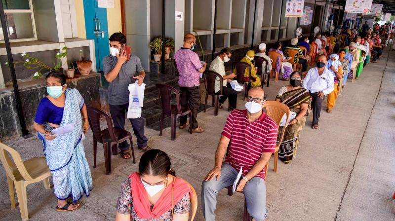 Citizens wait in a queue to receive a dose of COVID-19 vaccine at ESIS Hospital in Navi Mumbai. (Photo: PTI)