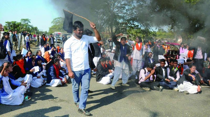 A file photo of college students blocking NH 37 in protest against the Citizenship (Amendment) Bill, 2016, in Dibrugarh in Assam.