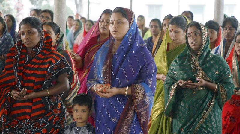 Bangladeshi Christian devotees offering prayers at a church at Nagori, near Dhaka. (Photo: AFP)