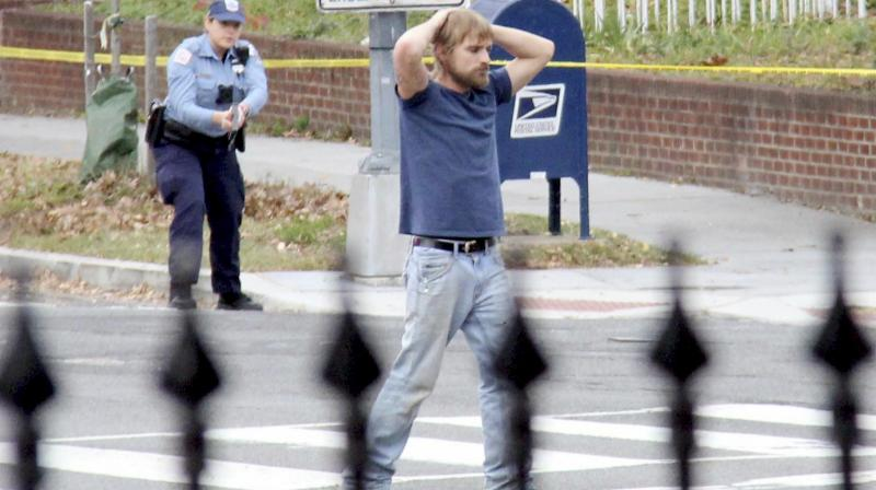 Edgar Maddison Welch, 28 of Salisbury, N.C., surrenders to police Sunday, Dec. 4, 2016, in Washington. Welch, who said he was investigating a conspiracy theory about Hillary Clinton running a child sex ring out of a pizza place, fired an assault rifle inside the restaurant on Sunday injuring no one, police and news reports said. (Photo: AP)