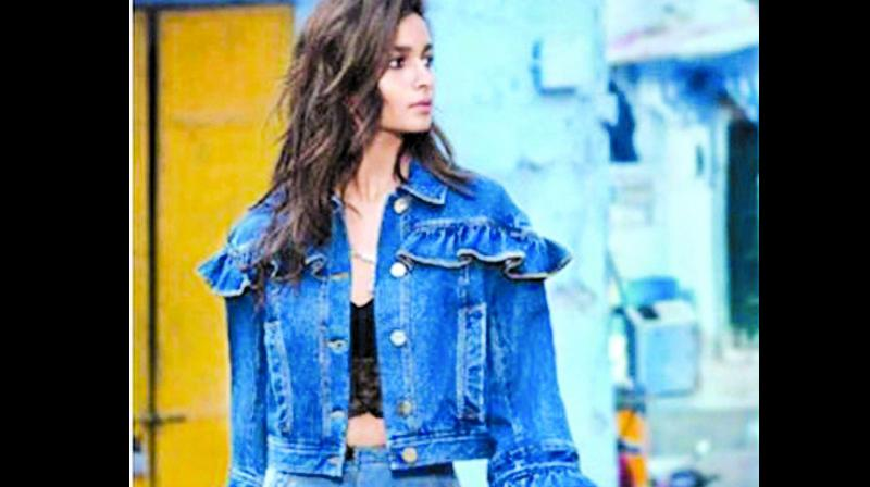 Alia Bhatt sure looks street chic in this black bralette paired with denim.