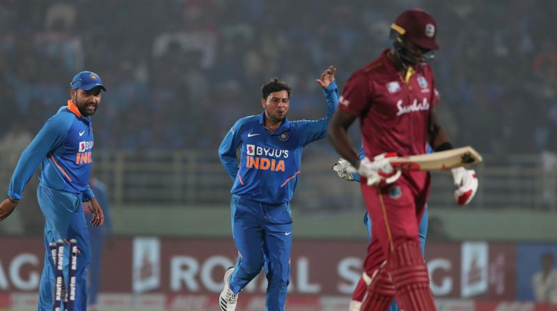 Spinner Kuldeep Yadav on Wednesday became the first Indian cricketer to take two hat-tricks in the International cricket. Yadav in his eight over dismissed in-form batsman Shai Hope (78), Jason Holder (11) and Alzarri Joseph (0) to etch his name in the annals of glorious history. (Photo:AFP)