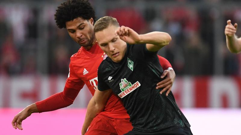 Bayern Munich's Joshua Zirkzee and Serge Gnabry scored stoppage-time goals to give the Bundesliga champions a 3-1 win at Freiburg on Wednesday. (Photo:AP)