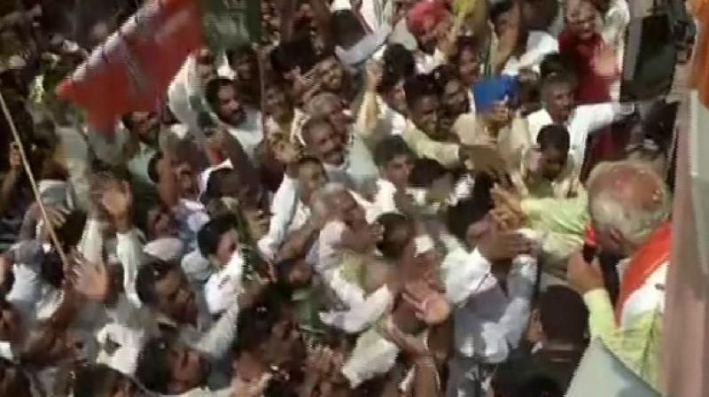 Khattar was seen waving hands to the supporters and public carrying the BJP flags, amid the chants of 'Bharat Mata Ki Jai'. (Photo: ANI)