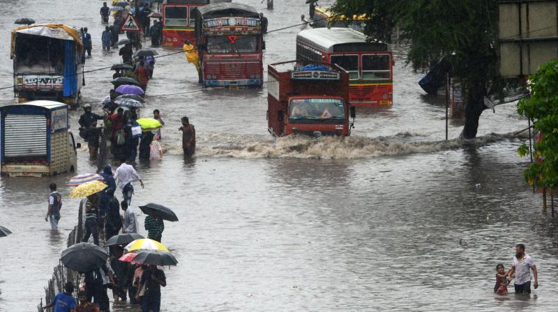 After a day's break, the rain was back in Mumbai, with the downpour since Saturday afternoon leading to waterlogging in places like Malad SV Road, Hindmata, King's Circle, Motilal Nagar, Chunabatti, Sion, Thakur Village and Kurla. (Photo: Rajesh Jadhav)