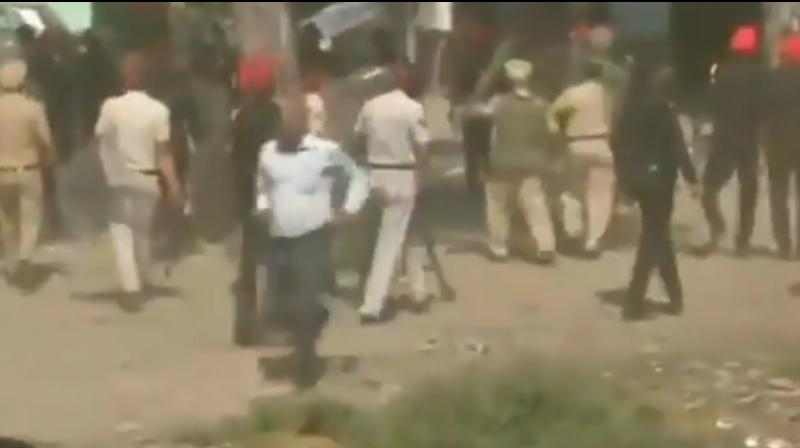 A Punjab police commando and a photojournalist were injured as the protestors, who were staging a sit-in at the site, started pelting stones and indulged in brick-batting. (Photo: ANI screengrab)