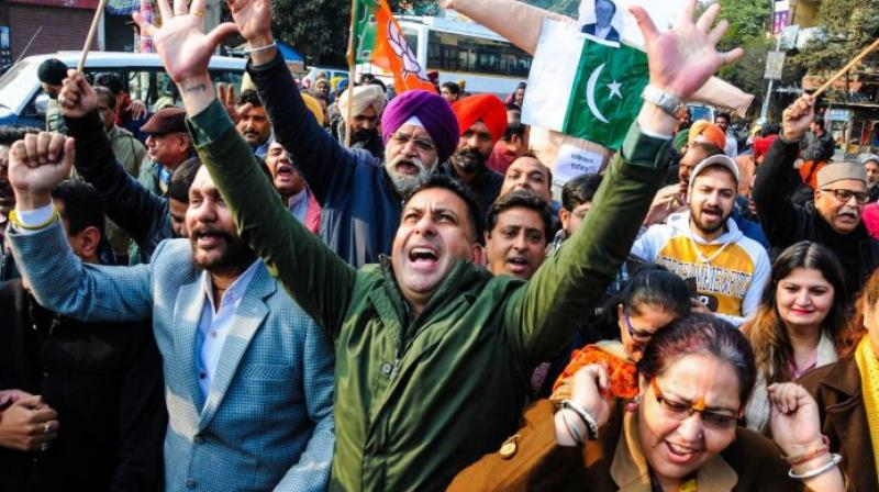 BJP workers shout slogans during a protest against Pakistan over alleged attack at on Pakistan's Nankana Sahib Gurdwara. (PTI Photo)