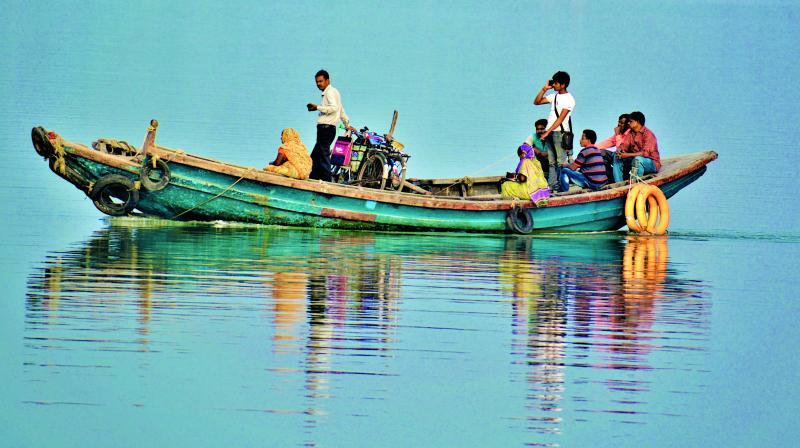 Locals commute from one island to the other in the Sundarbans