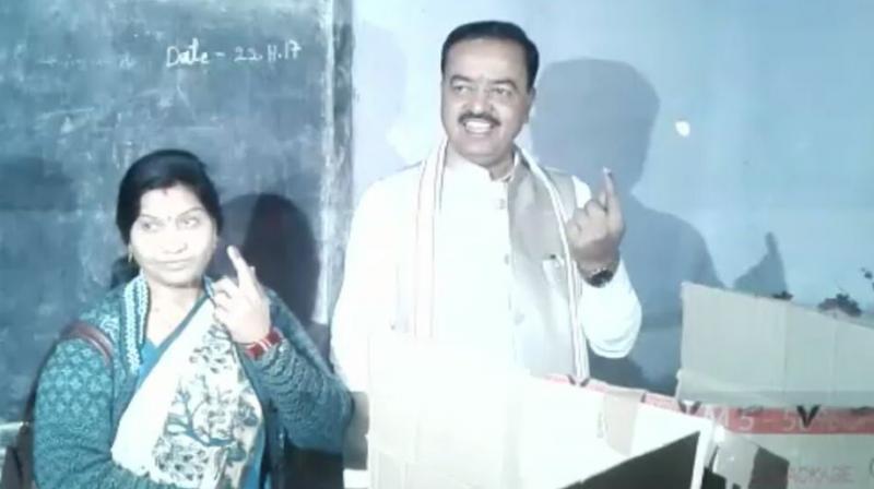 Uttar Pradesh Deputy Chief Minister Keshav Prasad Maurya  and his wife Rajkumari Devi cast their votes in Allahabad on Sunday morning. (Photo: Twitter | ANI)
