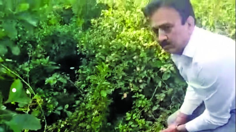 A video grab of a gun-toting Girish Mahajan.