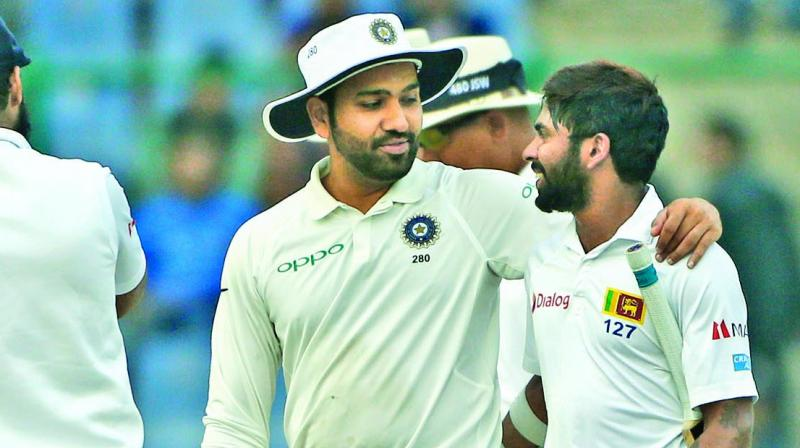 India's Rohit Sharma and Sri Lanka's Niroshan Dickwella after the final day's play. (Photo: PTI)