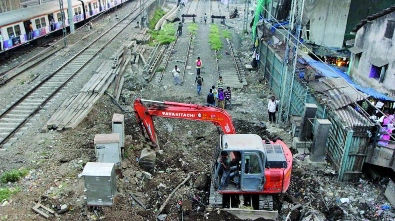 Construction work is underway near Andheri railway station as part of the extension of the harbour line all the way to Goregaon railway station.