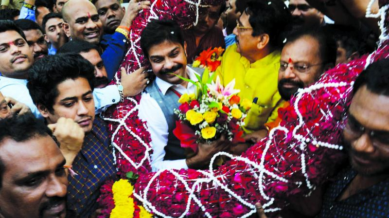 BJP workers greet Prasad Lad after his resounding victory in the legislative council byelection. (Photo: Rajesh Jadhav)