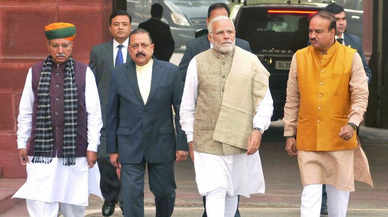 Prime Minister Narendra Modi with parliamentary affairs minister Ananth Kumar, ministers of state Jitendra Singh and Arjun Ram Meghwal, arrive to  address the media, on the first day of the Winter Session of Parliament, in  New Delhi. (Photo: Pritam Bandyopadhyay)