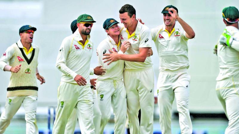 Australian players celebrate a wicket on the final day of the third Ashes Test against England at Perth. (Photo: AP)