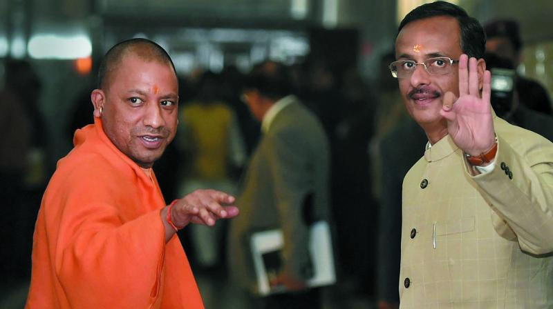 On the 'Hindi Journalism Day', Uttar Pradesh minister Dinesh Sharma (R) said one should remember one's glorious past and history.