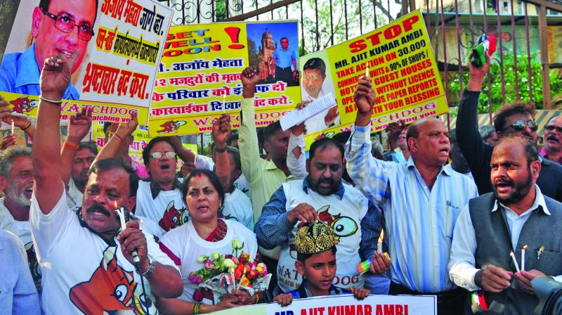 Parents and relatives of Sakinaka fire victims against BMC in L word in Kurla.