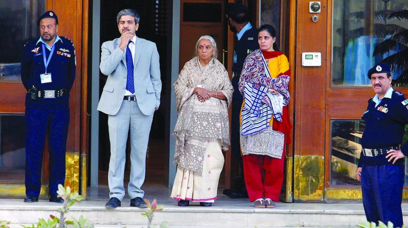 Kulbhushan Jadhav's (from left to right) wife, mother are being escorted by an Indian diplomat after meeting with Jadhav at foreign ministry in Islamabad, Pakistan. (Photo: AP)