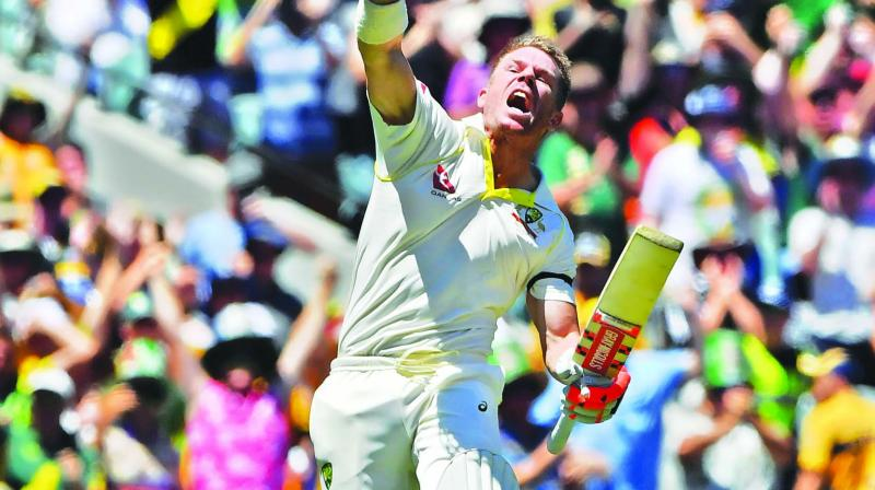 Australia's David Warner celebrates his century against England in the first day of the fourth Ashes Test in Melbourne. (Photo: AP)