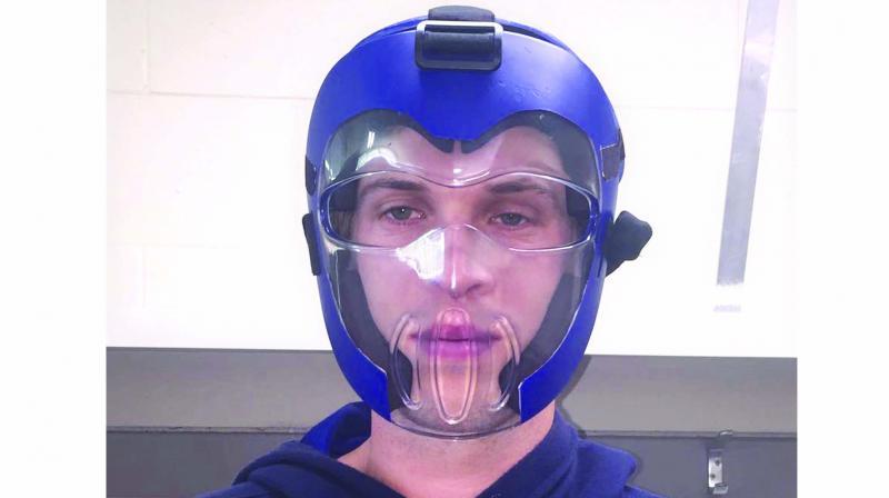 Warren Barnes wears a helmet made specifically for bowlers.