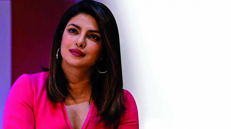 As she interacts with the audience, Priyanka Chopra patiently listens to a fan speak.