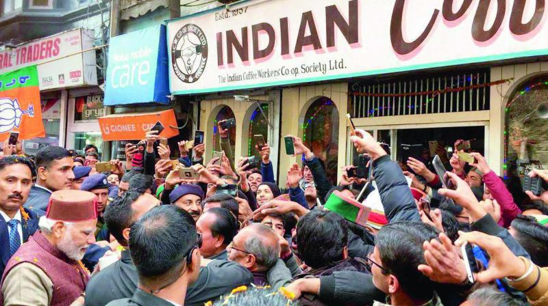 Prime Minister Narendra Modi  relishes coffee at the Indian Coffee House on Shimla's Mall Road after the swearing-in ceremony of Himachal Pradesh chief minister Jai Ram Thakur. (Photo: PTI)