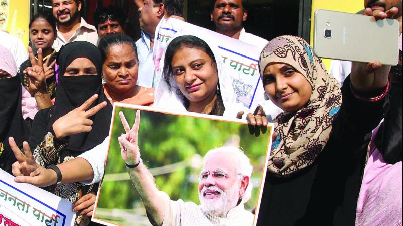 Women celebrate in Mumbai on Friday after the triple talaq bill was approved in the Lok Sabha. (Photo: PTI)