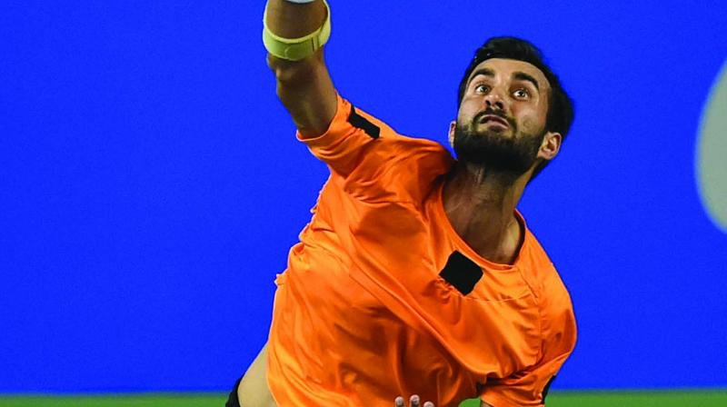 Yuki Bhambri in action against Arjun Khade in their Tata Open first round match in Pune. (Photo: PTI)