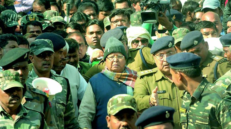 RJD chief and former chief minister of Bihar Lalu Prasad Yadav is produced at the special CBI court in Ranchi on Wednesday to receive his quantum of sentence in a fodder scam case. (Photo: PTI)