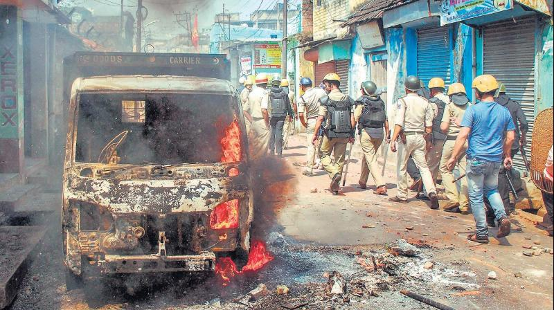 Police personnel patrol after clashes and incidents of arson over a Ram Navami procession in Raniganj, in Burdwan district of West Bengal, on Monday. (Photo: PTI)