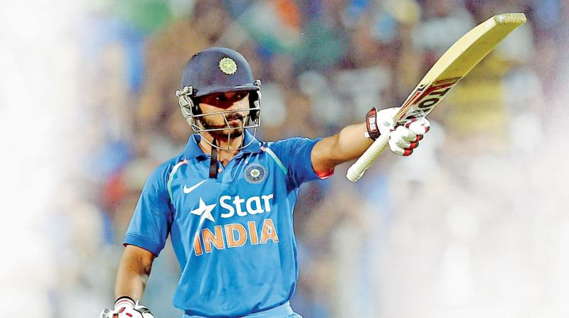 Kedar Jadhav celebrates his  century. (Photo: PTI)