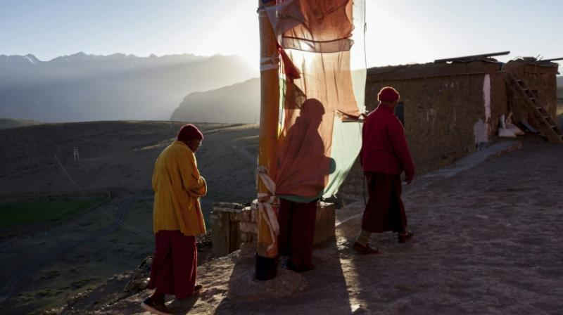 The monks and residents of the nearby village of Komik, said to be Asia's highest, are already feverishly preparing for winter, stocking up on food and fuel, drying vegetables -- and praying. (Photo: AFP)