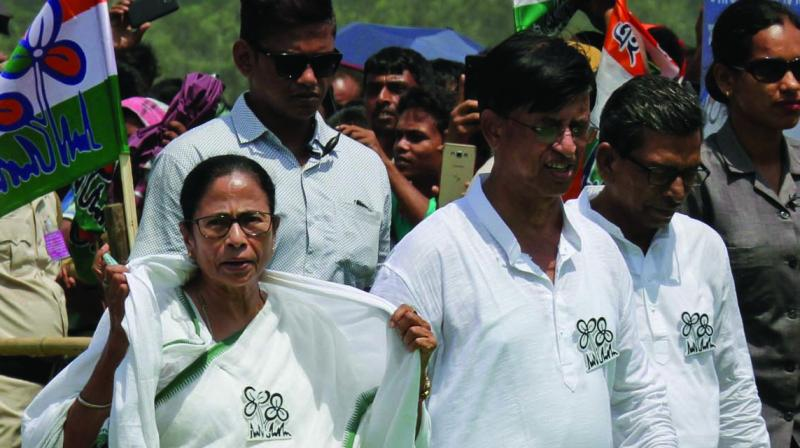 West Bengal CM Mamata Banerjee arrives to attend a rally at Mathurapur, near Kolkata, on Thursday. (Photo: AP)