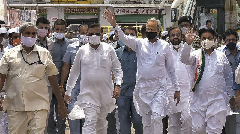 : Rajasthan Chief Minister Ashok Gehlot, Rajasthan PCC President Govind Singh Dotasra (R) and others arrive at party office, in Jaipur. PTI Photo