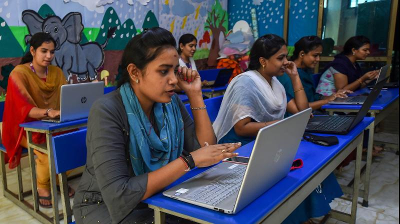 Teachers from Everwin Matriculation Higher Secondary School conduct online classes from their school premises, in Chennai. PTI Photo