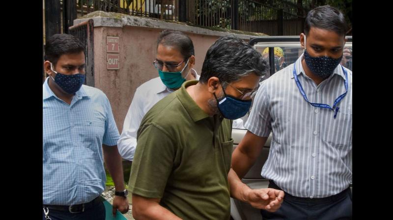 : Prof. Hany Babu of Delhi University being produced in NIA court, after he was arrested in connection with the probe into the 2018 violence in Maharashtra's Koregaon Bhima, in Mumbai. PTI Photo