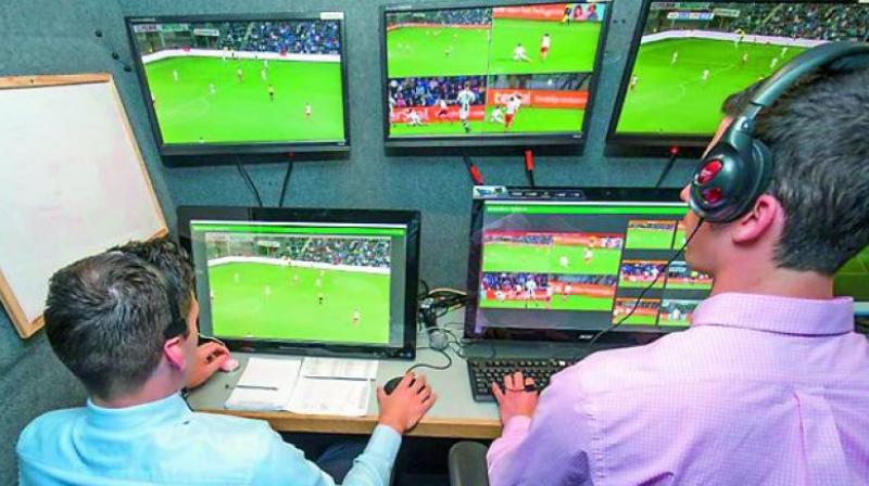 Video Assistant Referee and his team monitoring the match.