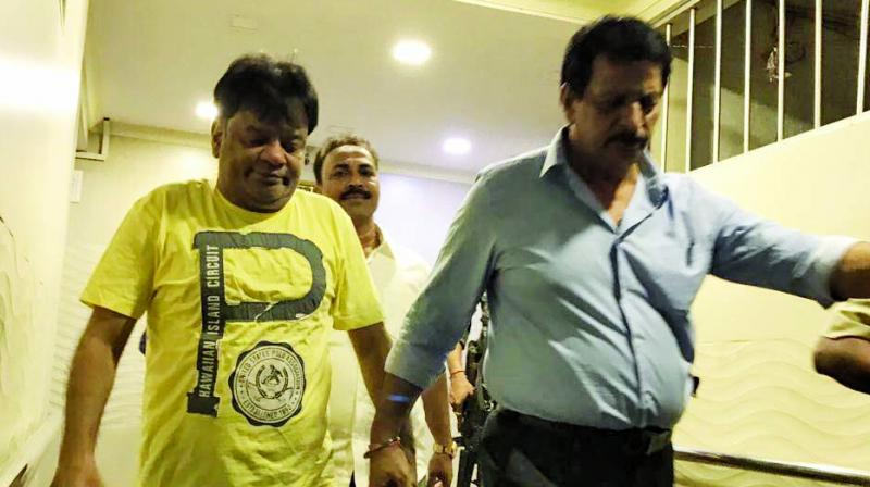 The Thane police arrested gangster Dawood Ibrahim's brother Iqbal Kaskar (yellow T-shirt) in connection with an extortion case.