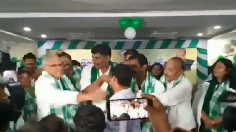 Chandrasekhar Sahu slapped Sangram Sahu, former Gajapati District Youth Congress president, who had attended the meeting to join the ruling BJD. (Photo: video screengrab)