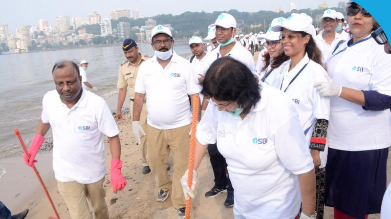 State Bank of India, SBI, chairperson Arundhati Bhattacharya takes part in Swachh Bharat Abhiyan or Clean India Movement on Monday. (Photo: SBI/Twitter)