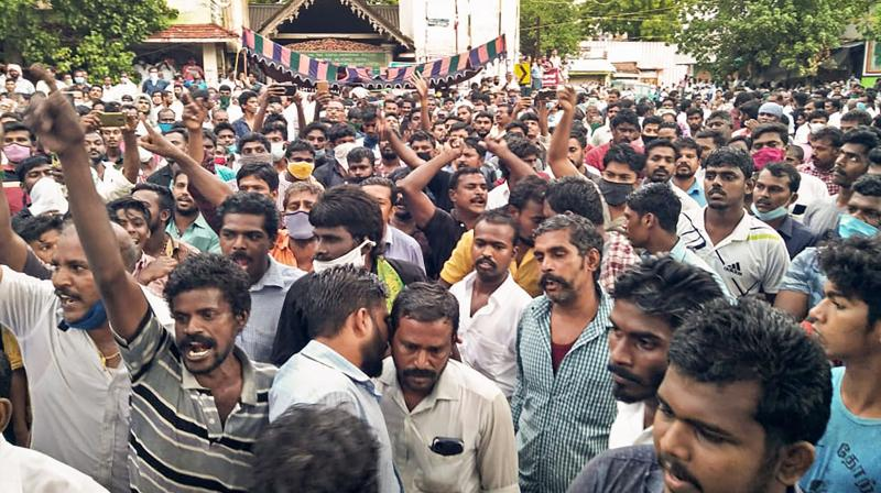 Villagers stage a protest in solidarity with custodial death victims, at Sathankulam in Tuticorin district, Sunday, June 28, 2020. P Jeyaraj (59) and his son Fennix (31), died at police custody on June 23 with relatives alleging that they were severely thrashed at the Sathankulam police station. PTI Photo