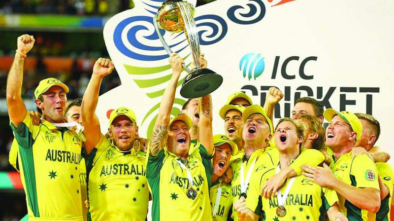 Michael Clarke lift the World Cup aloft as Aussies celebrate.
