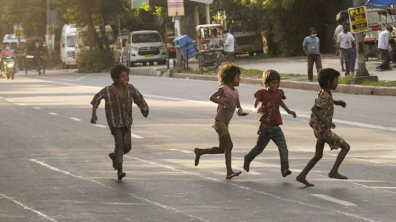 Children enjoy themselves on a traffic-free road in New Delhi. The central government announced several relaxations, beginning May 4, in the nationwide lockdown, which has been extended to May 15. (AA Photo: Pritam Bandyopadhyay)