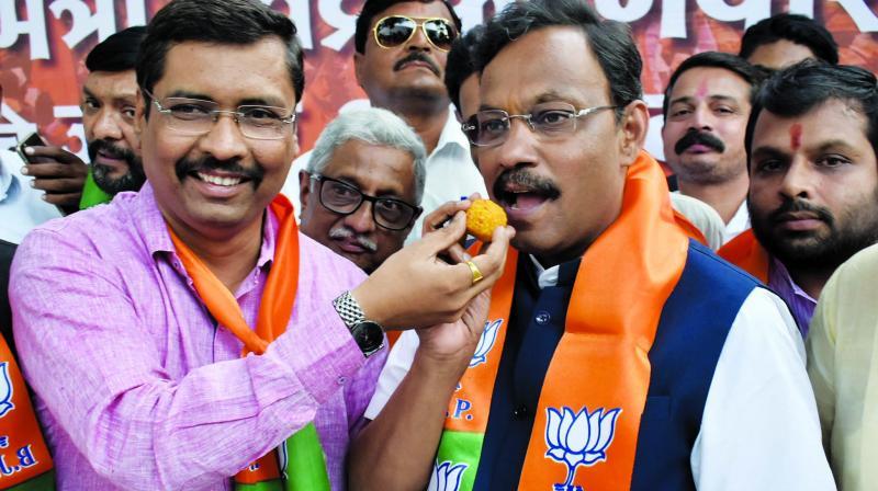 BJP spokesperson Keshav Upadhye and education minister Vinod Tawde celebrate the passage of Maratha quota bill in Mumbai. (Photo: Debasish Dey)